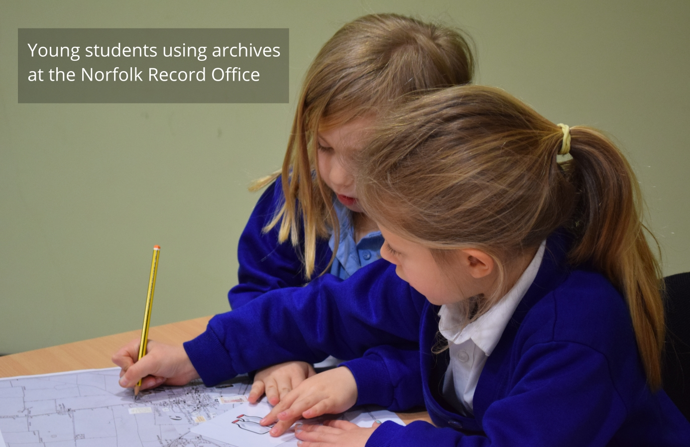 Young students learning from archives at the Norfolk Record Office